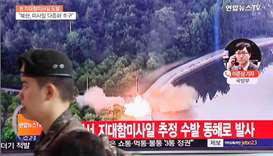 A TV broadcast of a news report on North Korea firing what appeared to be several land-to-ship missi
