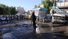 Woman suicide bomber kills at least 30 in Iraqi market