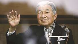 In this file picture, Emperor Akihito waves to well-wishers at the Imperial Palace in Tokyo.