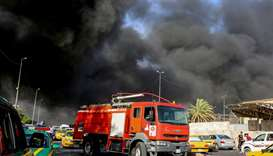 A fire truck arriving at the scene of a blaze at Iraq's biggest ballot warehouse