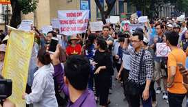 Vietnam police break up protest over controversial draft law