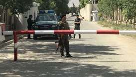 Suicide bomber kills 13, including women, outside Afghan ministry
