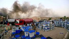 Ballot boxes are seen after a fire yesterday at a storage site in Baghdad, housing the boxes from Ir