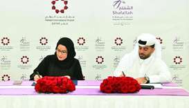 Engineer Badr Mohamed al-Meer and Amal Abdullatif al-Mannai sign MoU to add a special handling loung