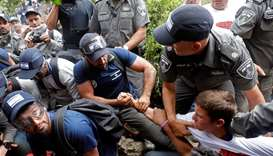 Israeli security forces scuffle with protesters during the eviction of Jewish settler families from