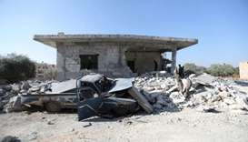 Syrians inspect the damaged of buildings