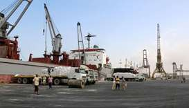 Workers unload food assistance provided by UNICEF from a cargo ship in the Red Sea port of Hodeida,