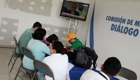 Journalists follow a live transmission of talks between representatives of Nicaragua's government an