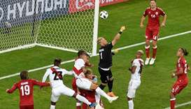 Denmark's goalkeeper Kasper Schmeichel (C) comes out to punch the ball from a corner.