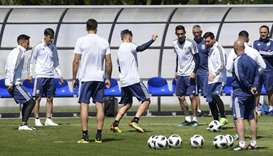 Argentina's forward Lionel Messi (3rd R) passes the ball during a training session at the team's bas