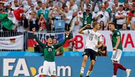 Mexico's Edson Alvarez and Carlos Salcedo celebrate at full time as Germany's Thomas Muller looks de
