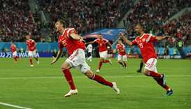 Russia's Artem Dzyuba celebrates scoring their third goal with Aleksandr Samedov