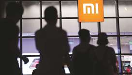 Xiaomi cuts valuation after pulling IPO