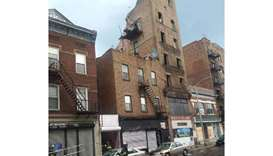 Woman rescued after trapped in collapsed building in New York