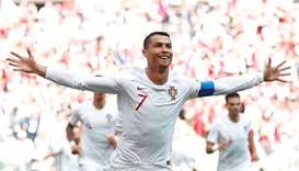 Portugal's Cristiano Ronaldo celebrates scoring their first goal