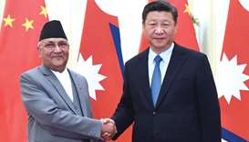 Chinese President Xi Jinping shaking hands with Nepal's PM Oli at the Great Hall of the People in Be