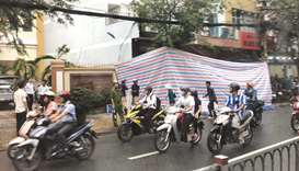 A tarpaulin covers the damaged facade of a police station in Ho Chin Minh city yesterday following a