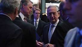 US Defence Secretary James Mattis talks to delegates before delivering his first plenary session of