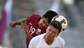 Qatar's defender Ahmed Alhama (L) vies with England's defender Dael Fry