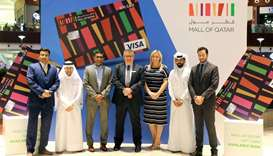 Officials mark the launch of the gift card