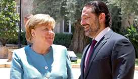 German Chancellor Angela Merkel (L) shakes hands with Lebanese Prime Minister Saad Hariri