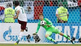 Mexico's Carlos Vela scores their first goal from a penalty past South Korea's Cho Hyun-woo