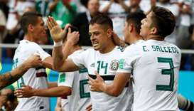 Mexico's Javier Hernandez celebrates scoring their second goal with Carlos Salcedo and team mates