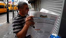 A man reads the Palestinian newspaper Al Quds that published an interview with Jared Kushner, US Pre