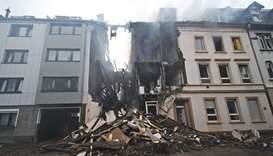Debris of the house that exploded in the night is seen on the street in Wuppertal, western Germany.