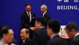 European Commission Vice President Jyrki Katainen (L) shakes hands with China's Vice Premier Liu He