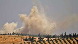 Smoke rises above opposition held areas of Daraa during an airstrike by Syrian regime forces.