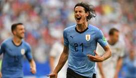 Uruguay punish sluggish Russia to top Group A