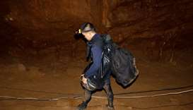 A rescue worker is seen inside of the Tham Luang caves