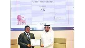 Dr Hassan al-Derham receiving the ranking certificate from QS official Ashwin Fernandes