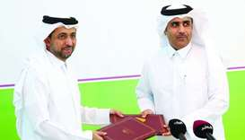 QU president Dr Hassan al-Derham and Kahramaa president Issa bin Hilal al-Kuwari exchange document a