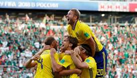 Sweden's Andreas Granqvist celebrates scoring their second goal with team mates