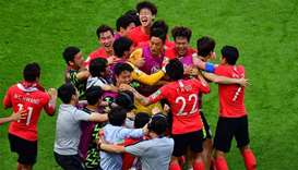 South Korea's players celebrate their goal during the Russia 2018 World Cup Group F football match b