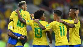 Brazil players celebrate their opening goal during the Russia 2018 World Cup Group E football match
