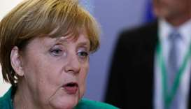 Merkel eases migrant row with Greece, Spain accords