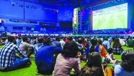 Thousands of spectators enjoying the live screening of football matches at the fan zone.