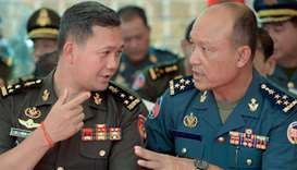 Lieutenant General Hun Manet (L), the eldest son of Cambodian Prime Minister Hun Sen, speaks to Camb