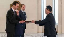 President Bashar al-Assad (L) receiving diplomatic credentials from North Korea's newly-appointed am