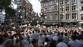 Thousands march for Belgium terror shooting victims