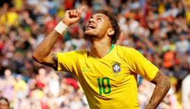 Brazil's Neymar celebrates scoring their first goal