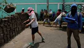 Demonstrators set up a barricade during protests in Monimbo neighborhood in Masaya, some 40km from M