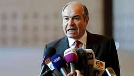 Jordan's Prime Minister Hani Mulki speaks to the media