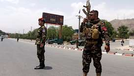 Afghan security forces keep watch at the site of the attack