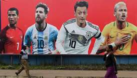 A football billboard displaying (From L) Portugal's forward Cristiano Ronaldo, Argentina's forward L