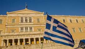 Greece submits reforms to parliament, aiming to unlock last bailout loans