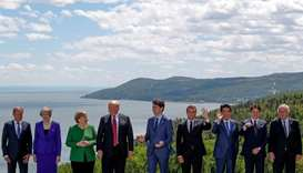 G7 leaders pose for a group photo at the G7 Summit in the Charlevoix city of La Malbaie